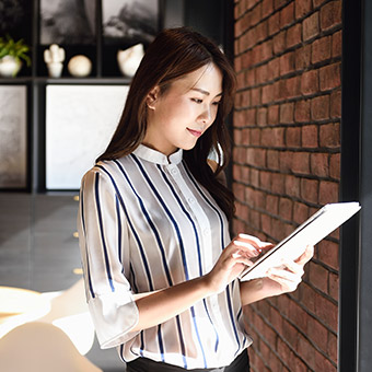 Small business owner reading BusinessFirst